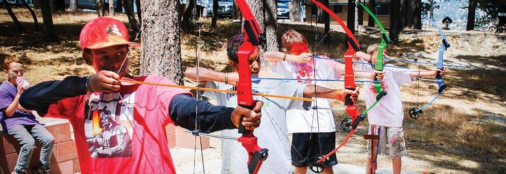 kids with bow and arrow