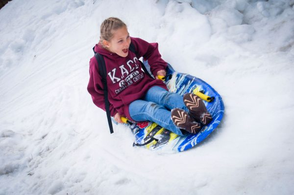 girl sledding angeles crest