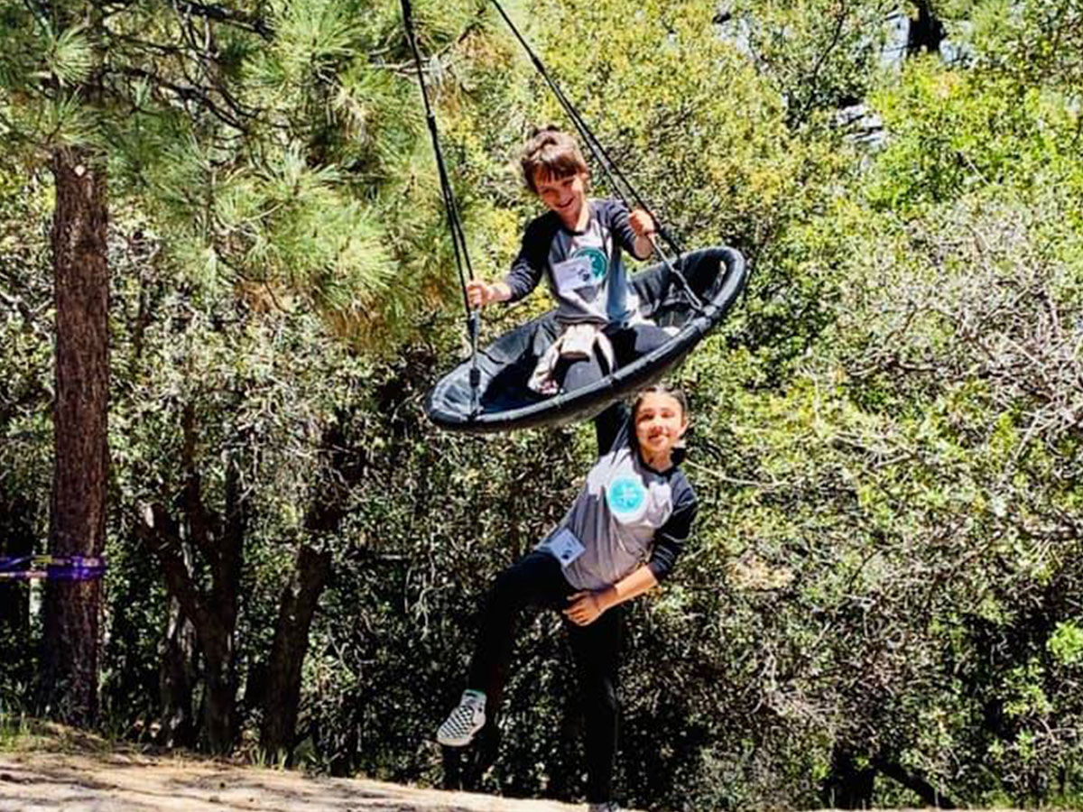 Kids playing on the swing at Angeles Crest Family Campground