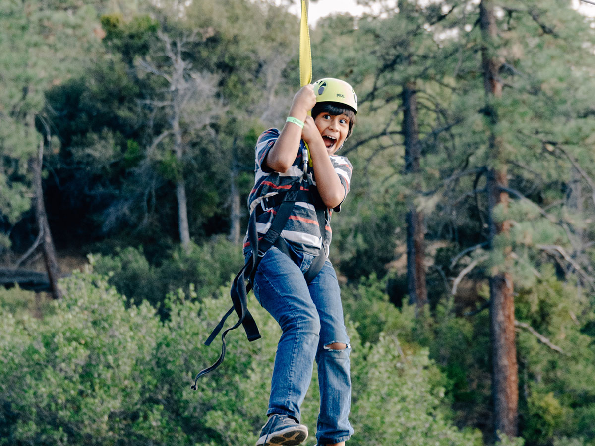 Boy on the zipline at Angeles Crest Christian Camp
